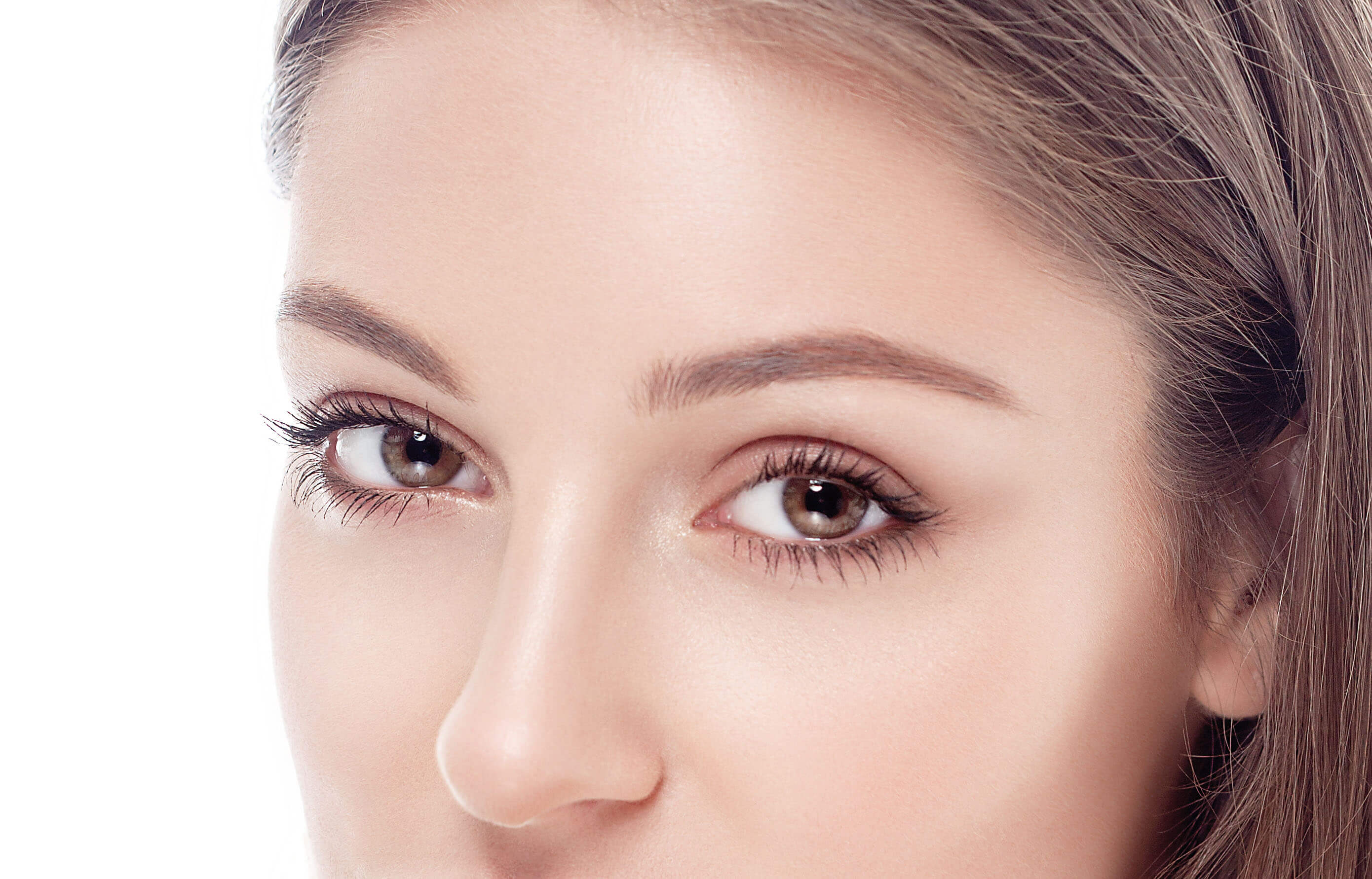 Beautiful woman eyes and nose studio on white backgound